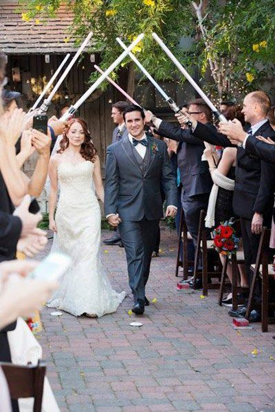 Use light sabers to create a memorable recessional archway or reception entrance.Photo Credit: Juice Box Media via Rebel Belle Weddings