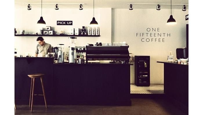 The black, white, and wood theme of One Fifteenth Coffee in Jakarta.