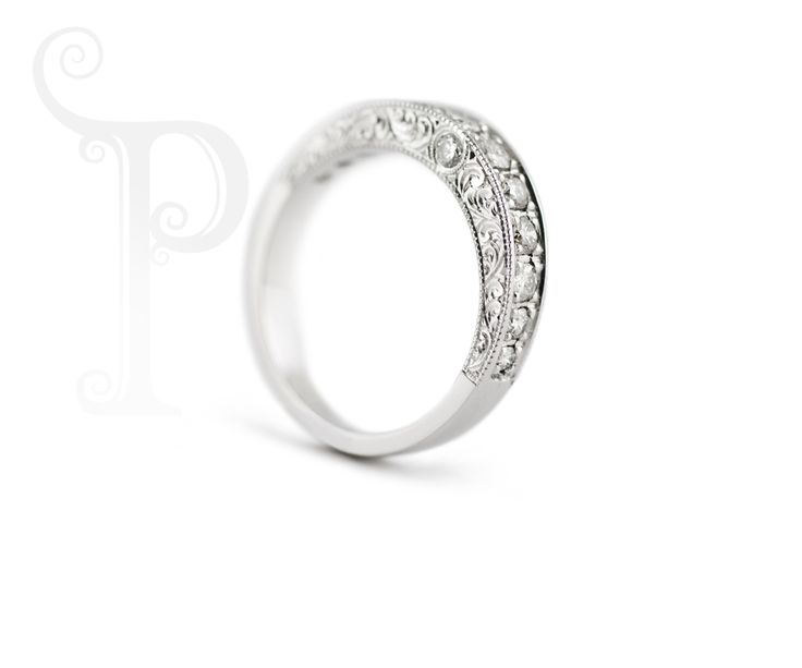 Handmade Platinum Band with hand engraving , set with round brilliant cut Diamonds