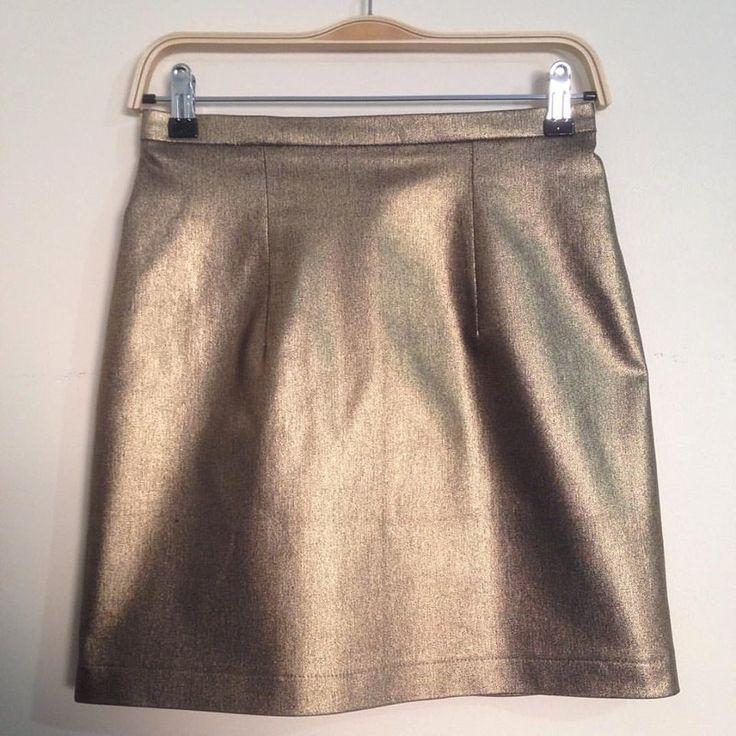 'Lula' skirt in gold foil denim by Peta Pledger.