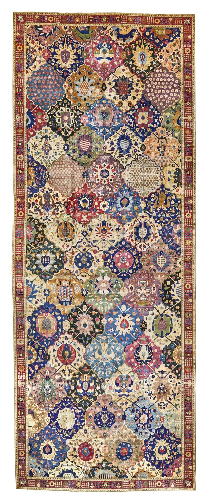 Indian Lahore garden gallery rug, with a 'compartment vase' design, approximately 736 by 281cm, first quarter 20th century, Sotheby's