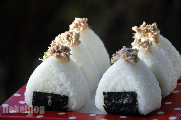 You can also wrap your Onigiri entirely with a sheet of nori or use Shiso leaves (Japanese basil). If you use different fillings it's clever to make an indentation on the top of your rice ball and fill it with the same filling that is inside of it, so later on you'll know which Onigiri contains which filling. Cut out little mouths and eyes, stick them on the rice and your Onigiri will look as cute as a button!