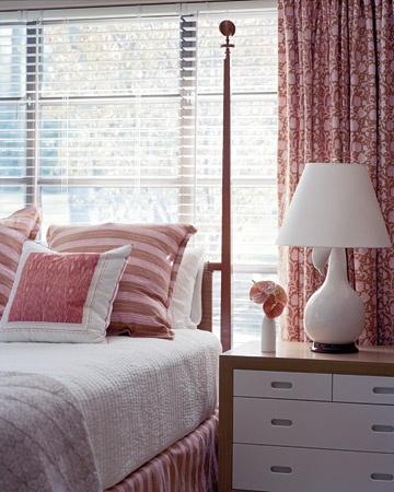 Guest room:  red + white palette; bed (vintage Tommi Parzinger); Gooseneck gourd lamp (Christopher Spitzmiller); bedding (John Robshaw)