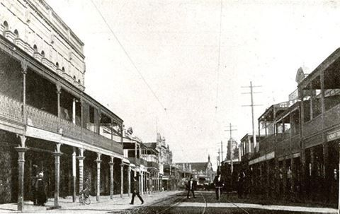 King Street, Newtown. ... c.1880s-1890s ... South Sydney Council photos from Edda Boyd. Streetscape; view south from near Horden St along King St towards Erskineville Rd showing horse & cart, pedestrians, bicycles & the Methodist Church (in the centre background) ... SRC24680 / City of Sydney Archives