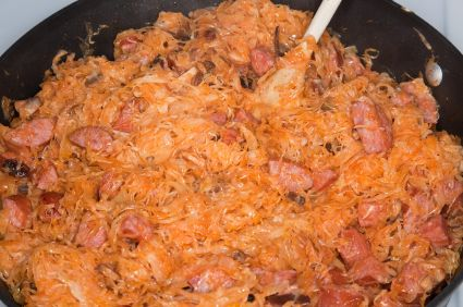 Bigos: 1/2 medium cabbage; 4 cups of sauerkraut; 1 can tomato paste; 1/2 lb bacon sliced; 1 lb pork diced (any parts that can be sautéed is good); 1 lb Kielbasa sausage sliced (optionally substitute with a quality nitrate free etc. sausage. 1 large onion diced; 2 cloves garlic minced; 1 bay leaf; Optional salt and pepper to taste;