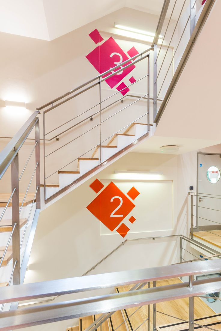 Office Design - Hallway - Stairwell - Signage - Pink - Orange - Accent Wall - Numbers - Levels - Painting - Office Fit Out - The Chancery Building, Dublin by Think Contemporary
