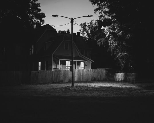 Adam Bellefeuil ------ lone light with house, sky is bright but still dull. frames the top of light naturally. there's depth to the image