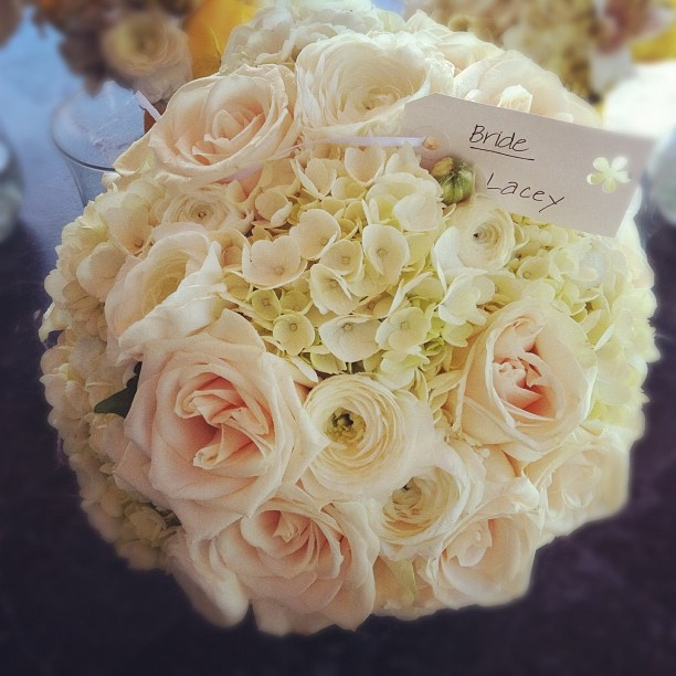 brides bouquet of white hydrangeas ranunculus garden roses flowers by something blue weddings