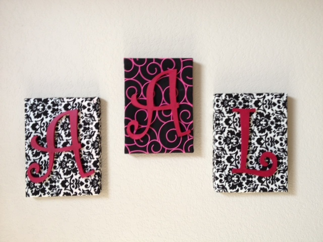 All it took was about an hour with fabric, wooden letters, glue gun, and shoe box lids.  Mod Podge can be used also.  Using shoe box lids is definitely the cheaper way to go.