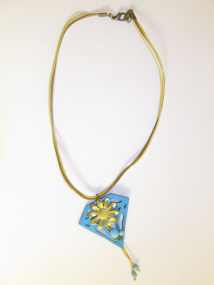 Handmade short leather necklace (1 pc)  Made with turquoise leather filigree, leather cords, vintage brass flower, glass bead and details of turquoise stones.