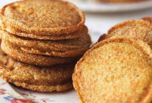 Cornmeal Griddle Cakes  Recipe (Cornmeal griddle cakes, also known as hoe cakes, can be made with little more than cornmeal, a bit of oil, water, and a hot skillet. The result is a crisped exterior, an ethereally airy interior, and a texture that's pleasantly gritty through and through.)