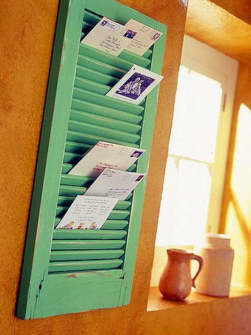 Use Flea-Market Window Shutters  Window shutters in all shapes, sizes, and colors dot flea markets. Hang a short one on the wall for organizing bills and other mail, Photos or purchase a wider one for holding magazines and catalogs.