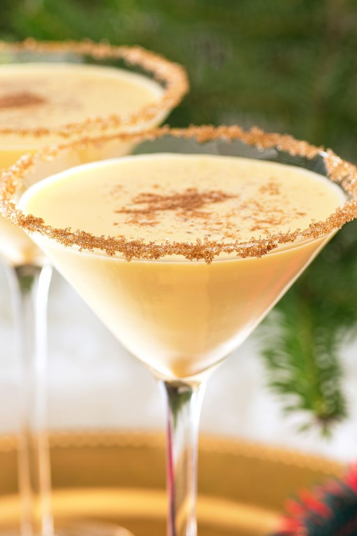 Holiday Eggnog Martini Recipe with Cinnamon Sugar, Brandy, Amaretto Liqueur, Nutmeg, Vanilla Ice Cream and Cinnamon Sticks