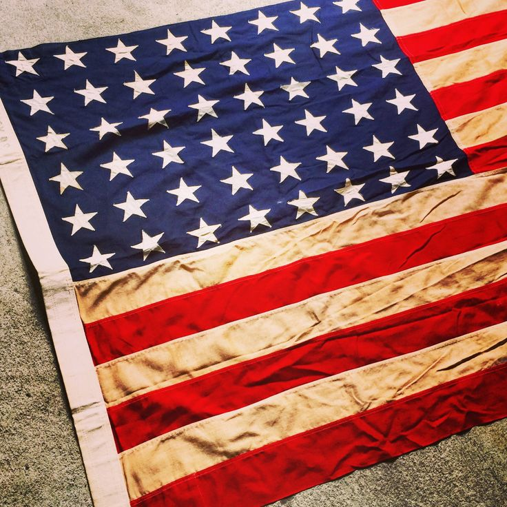 A personal favorite from my Etsy shop https://www.etsy.com/listing/519457462/48-star-flag-american-flag-linen-flag-35