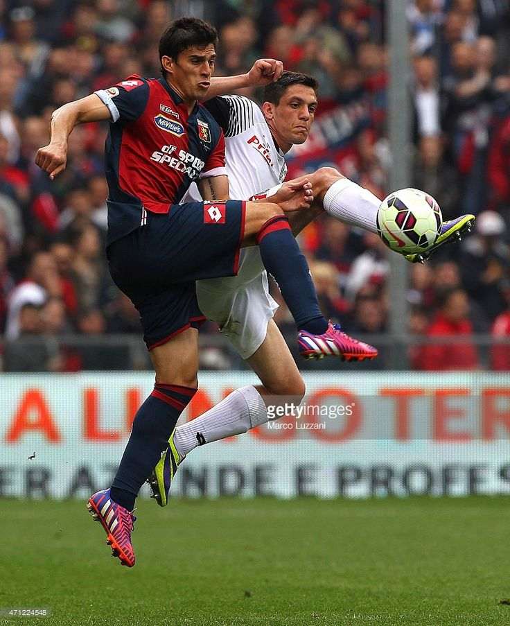 Diego Perotti of Genoa CFC competes for the ball with Costantin Nica of AC Cesena during the Serie A match between Genoa CFC and AC Cesena at Stadio Luigi Ferraris on April 26, 2015 in Genoa, Italy.