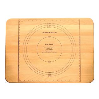 Catskill Craftsmen Inc. - Perfect Pastry Measuring Board - The Perfect Pastry Measuring Board is a stylish and simple way to measure and cut dough for baking. Crafted from sustainably harvested domestic hardwood, this board features a flat grain pattern, metric and customary measuring rulers, pie crust sizes, and a pastry recipe. A juice groove on the reverse side of the board holds excess waste and prevents messes. Its oiled finish makes for easy cleaning. Made in the USA.