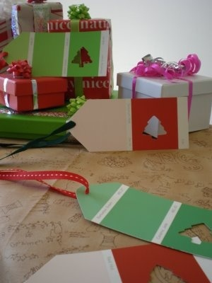 Quick Christmas Gift Tags ~ Use paint chip cards  Christmas paper punches  hole punch. Write the TO: on the middle color. Could also be made for Birthdays with Birthday paper punches or other gift giving occasions!
