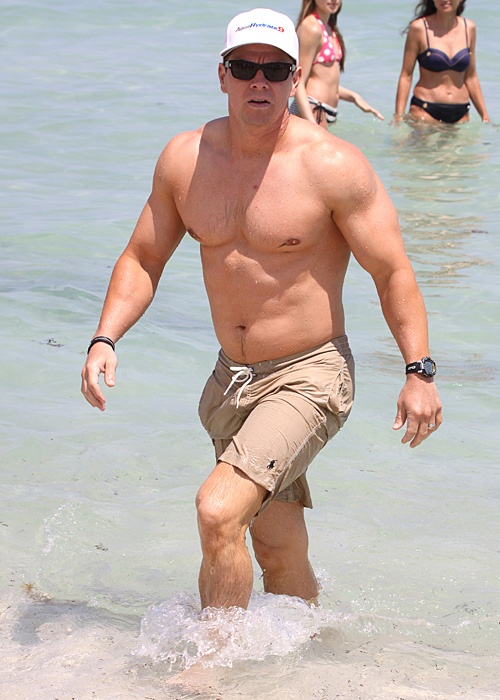 #Bikini Awards: Maybe Mark Wahlberg is annoyed at this camera guy, but it's not like he worked on that body to HIDE it from us!: Photos Galleries, Celebrity Photos, Celebrity Bikinis, Abs, Launch Mark, Swim Trunks, Mark Wahlberg, Bikinis Awards, Camera Guys