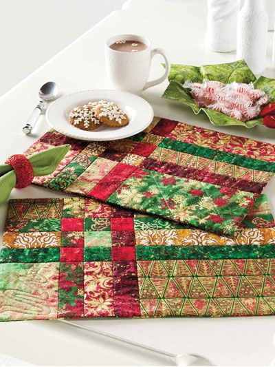 """Start with a simple Nine-Patch and stretch it into a fabulous place mat that's perfect for any occasion. This e-pattern was originally published in the Quilter's World special publication Quilting for the Holidays. Size: 17 1/2"""" x 12 1/2"""". Skill Level: Beginner"""