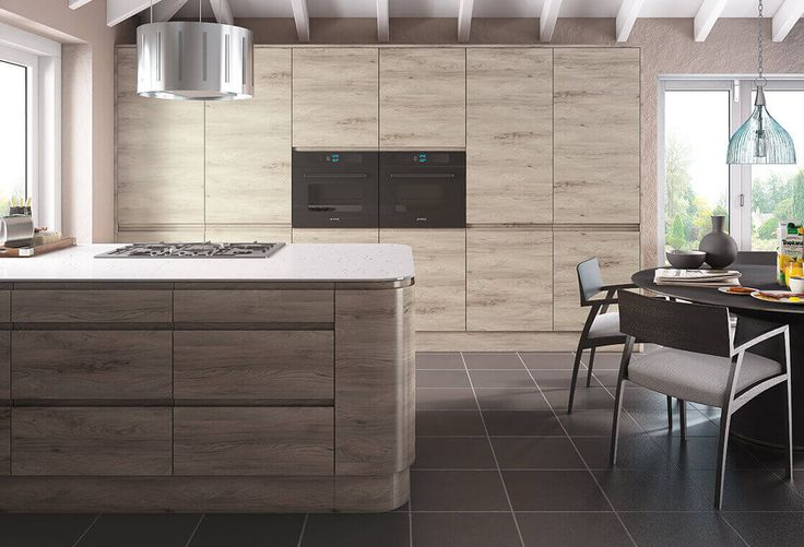 Jura collection Perfect for apartments, this light wood handleless, concealed kitchen really is a hidden gem. The horizontal wood grain and standalone island expand the living space without compromising on quality