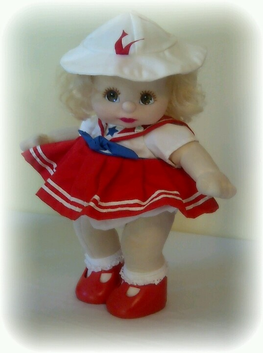 1985 My Child Doll girl with blonde curly hair and brown eyes wearing an original  red sailor dress, matching  hat & red tbar shoes.
