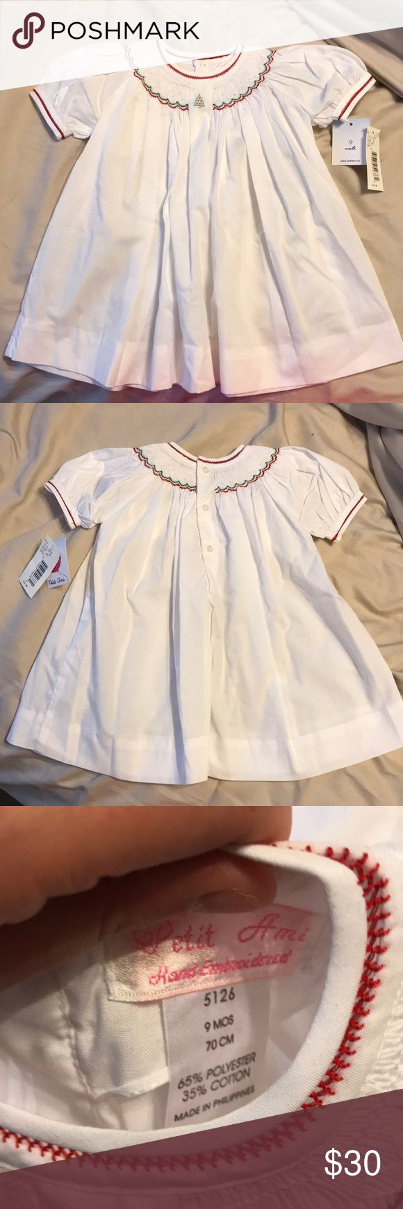 Petit Ami Smocked Christmas Dress Beautiful smocked Petit Ami Christmas dress. Had red trim at the sleeves and 3 buttons on the back. NWT! Petit Ami Dresses