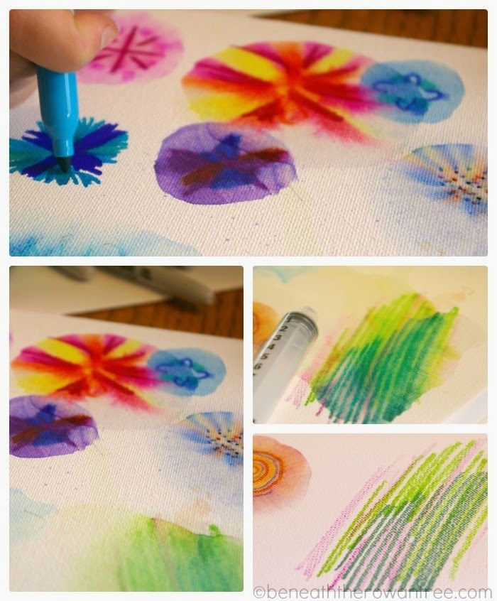 Sharpies & alcohol on a canvas. Makes for an interesting wall piece. I would do small petal shapes in different colors!