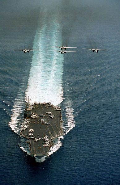 F-14A Four Tomcats Formation Over Carrier English: A four ship formation of US Navy (USN) F-14A Tomcats fly over the USN Nimitz Class Aircraft Carrier USS DWIGHT D. EISENHOWER (CVN 69). Date 22 May 1995