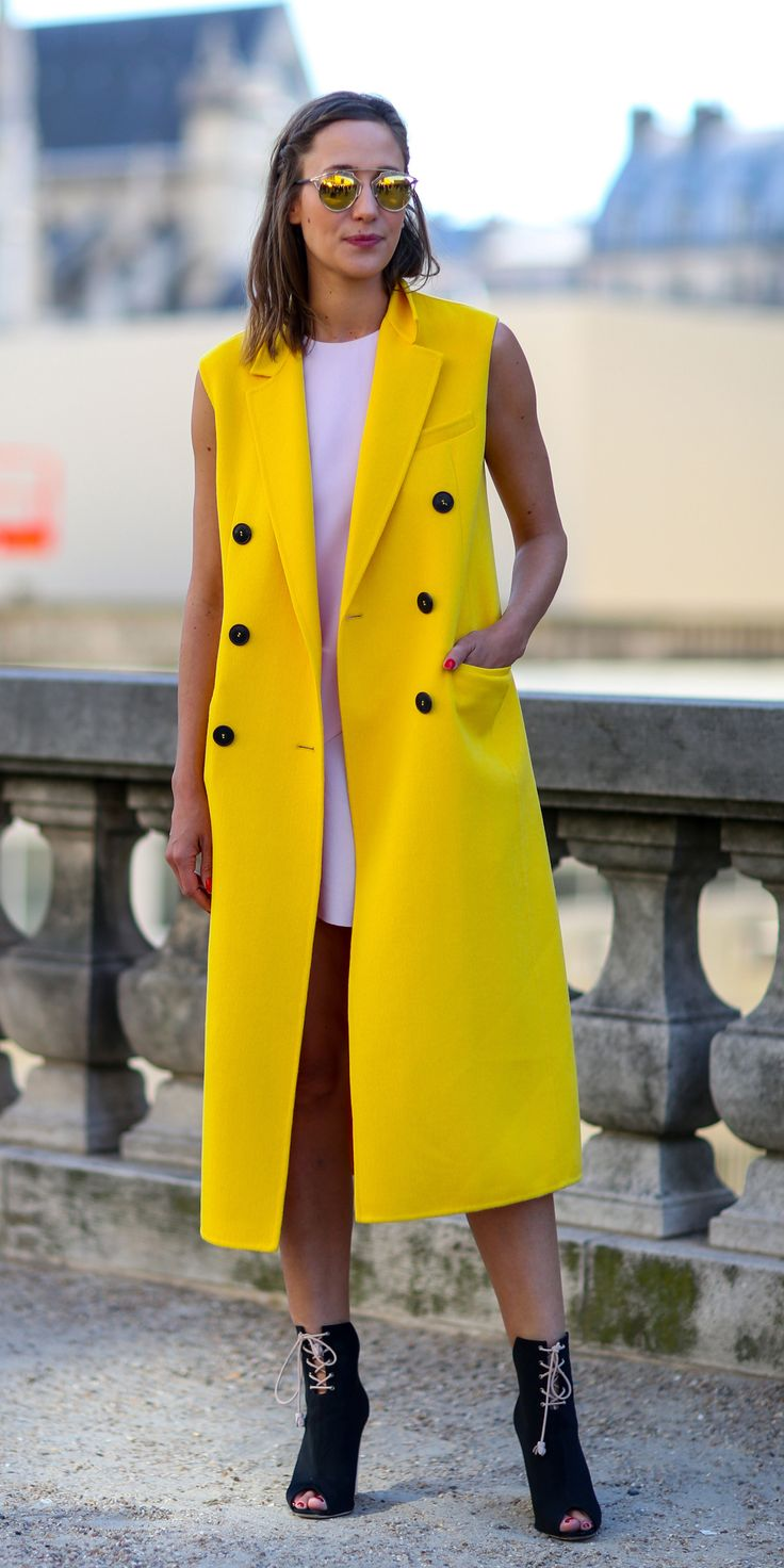 #ranitasobanska #fashion #inspirations Yellow sleeveless coat for a strong silhouette and pop of color. See more coats on ShopStyle.com