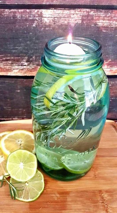 Camping Hack: DIY mosquito repellant. All you need is some lemon and lime wedges, sprigs of rosemary, water, lemon eucalyptus oil, floating tea candles and a mason jar. #CampingHacks #CampingTipsAndTricks #Outdoors