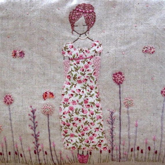 I love the applique technique here joined with minimalist embroidery.  Is she not lovely?