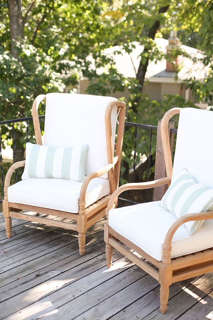 lake house deck with teak furniture