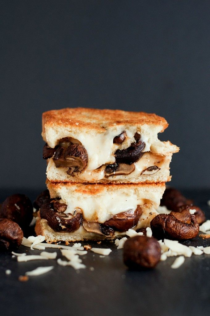 The Swiss Mushroom Melt Grilled Cheese | Juicy mushrooms, encompassed in stringy, melted swiss cheese. MMM MMM! Sauteing whole mushrooms, rather than chopping or slicing them, gives this sandwich some great meatiness as you bite into it, getting a big juicy mushroom, mixing with the swiss cheese flavour! Soo good! | From: bsinthekitchen.com