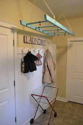What a great idea! Ladder in the laundry room for a great laundry room organization idea.