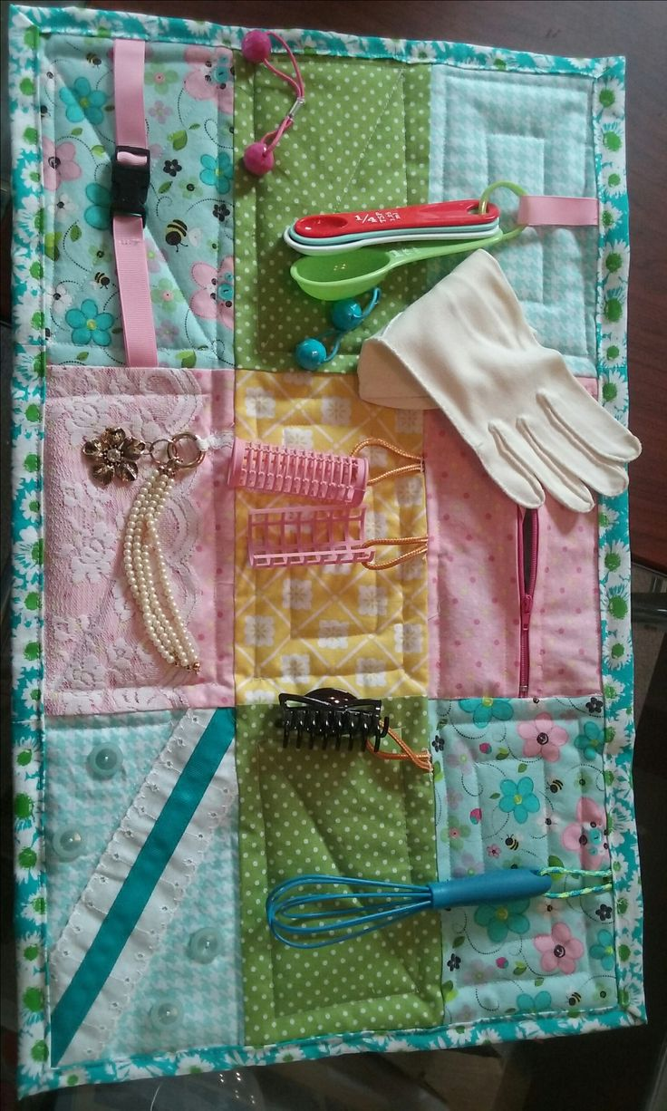Fidget blanket I made and donated to company that cares for Alzheimer's clients.