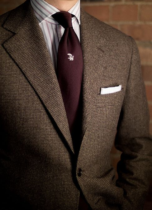 Donegal tweed jacket, white shirt with red and black stripes, burgundy tie