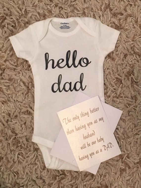 Pregnant or trying to get pregnant and looking for a cute way to tell your soon to be babys dad then this listing is for you!!! This listing is for a hello dad, hello grandma, hello grandpa, hello grandparents, hello aunt, or hello uncle. 0-3 month short sleeve white onesie. You can also choose to add the husband Or a personal note you choose the wording for to go along with your onesie. Each note comes with an envelope. This is the perfect way to tell anyone your Prego! If purchasing the…