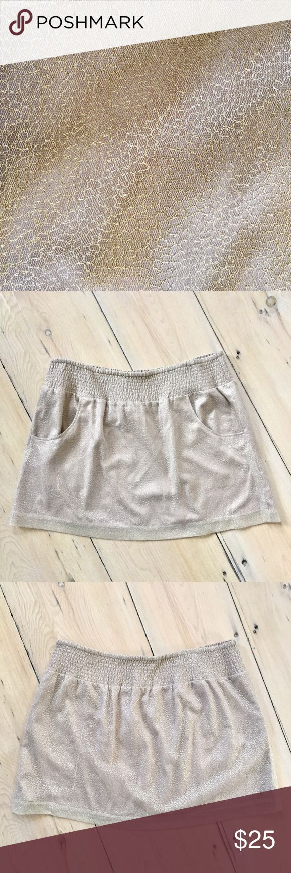 """💥HOLIDAY SALE🍗💥 price goes up 12/1 NWT GAP Gold Metallic Mini Skirt in size XL.  Shiny metallic gold on mesh overlay with elastic waistband, 2 front pockets & full lining. Contents: 85nylon/15metallic.  Measurements (laid flat): Waist: 19"""" to 26"""".  Length: 18"""".  NWT - never been worn. But there is an imperfection on the back left side on the overlay - looks like it might be a vertical pull (see last photo) so this is priced accordingly. No trades.  #171120 GAP Skirts Mini"""