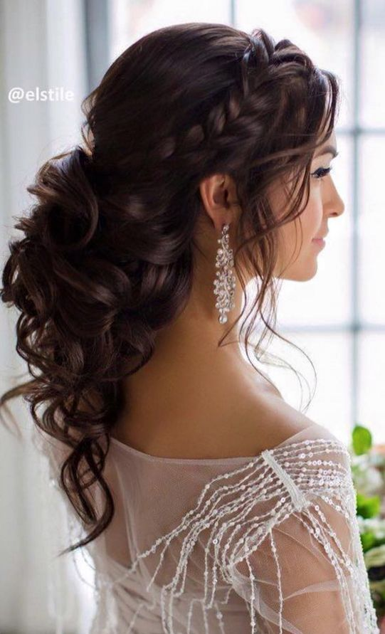 Braided and curled half-up style