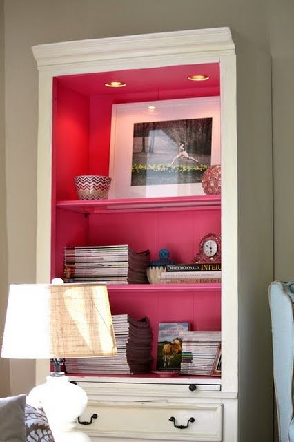 paint the inside of a bookcase. this is great for adding a pop of color to a room without painting the walls. @ DIY Home Design
