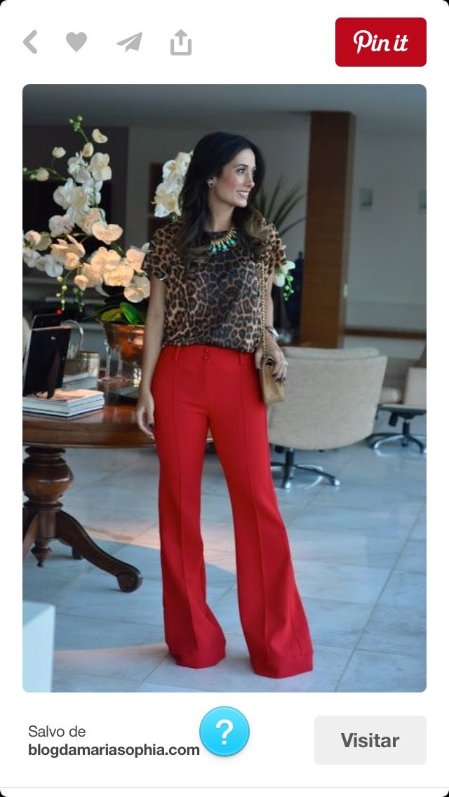 red jeans, animal print top, and turquoise jewelry with brown shoes