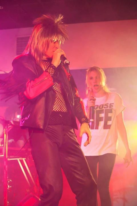Mesh shirt and a mullet - and a Choose Life tshirt in the back. That's 80s alright. Electric 80s Show keeping it real