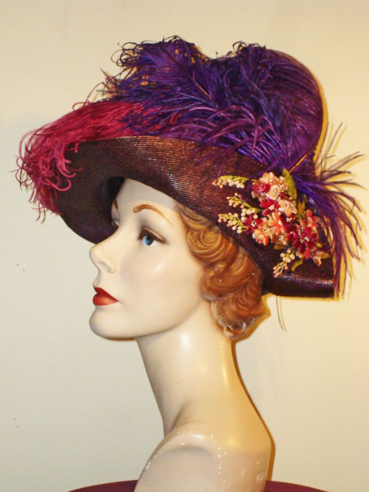 Purple straw tricorn with ostrich feathers in pink and purple and pink velvet floral spray ca. 1905
