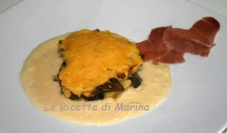 Sformato di patate e funghi su fonduta di formaggio