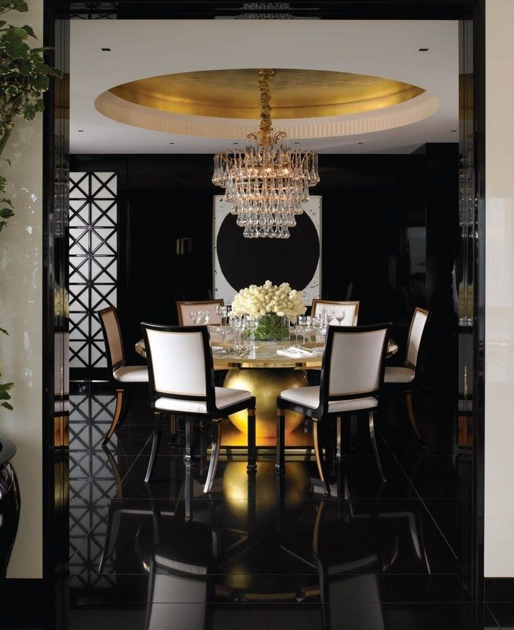 So elegant and dramatic. Black, white and gold dining room