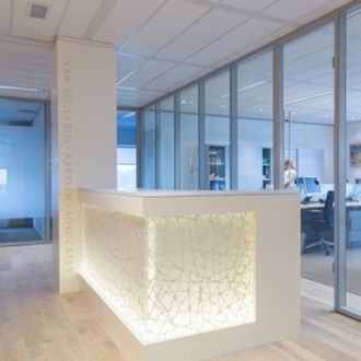 Designer Natascha Knijff created a new light, inviting interior for a law firm with a back lit 3form Varia Connection Pure reception desk with an L-shaped Chroma top surface.