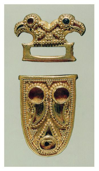 Kunbábony. Hungary. Avar. ca. 600-699. Gold strap_end and bird_head mount decorated with granulation and glass inlay. Katona J. Museum