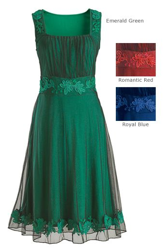 """Festive Dress Out of a blue mist she emerges, dancing gracefully - the figure of dreams. The deep royal blue of this dress is lightly veiled by the airy black netting overlayer; enlivened with a flourish of fanciful embroidered leaves and vines. Dress is soft, beautifully-draping viscose rayon jersey knit, with black nylon net overlayer. Hand wash. 40"""" long, sizes S-XL, 2X, 3X. Imported. Also available in Emerald Green or Romantic Red."""