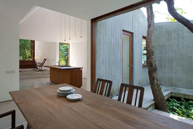 dining room  #whitespaces #openkitchen #kitchenisland #slidingwindows #weekendhome #courtyard #diningtable