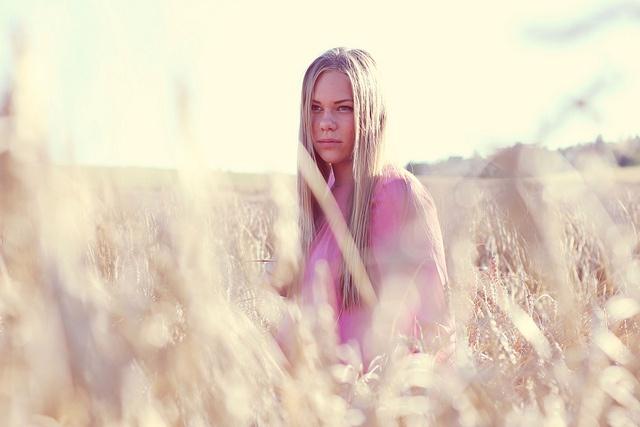 I found a girl sitting in field.